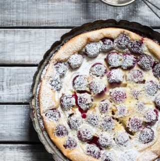 Overhead photo of cherry clafoutis sprinkled with powdered sugar.