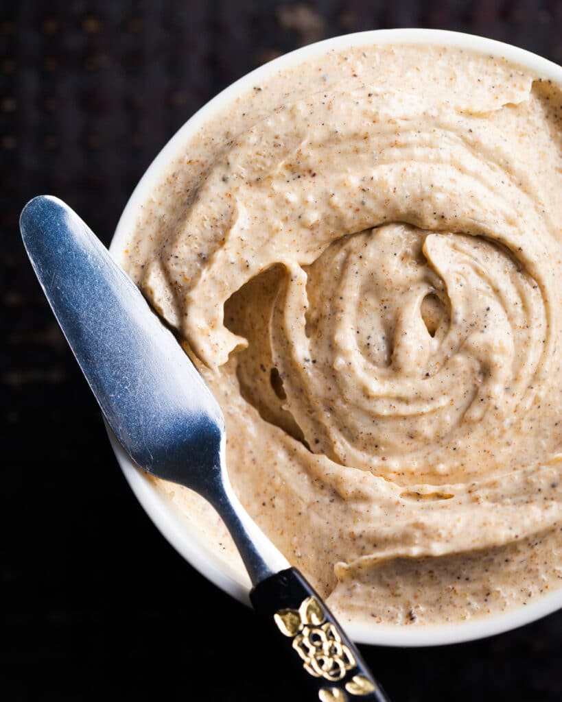 A small bowl of Whipped Brown Butter Spread With Cardamom And Vanilla.