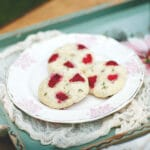 Three scones on a pink and white plate.