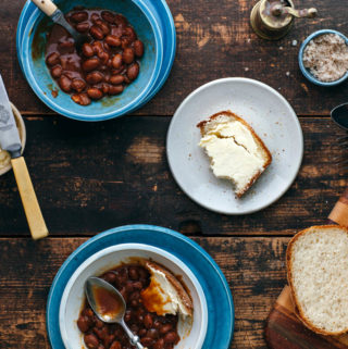 A lunch for two with homemade molasses baked beans with bacon.