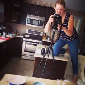 Kelly Neil filming a food video in her kitchen.jpg