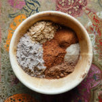A bowl with ground spices for homemade chai spice.