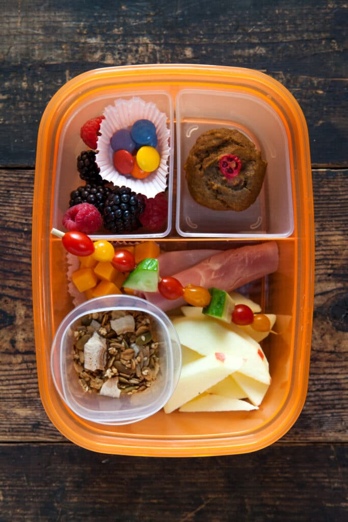 Overhead of plastic bento box lunch without lid.