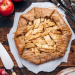 Overhead of an apple galette on a wooden table.