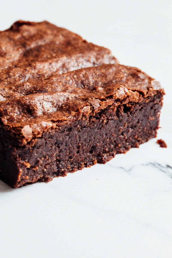 A side view of one double chocolate buckwheat brownie.