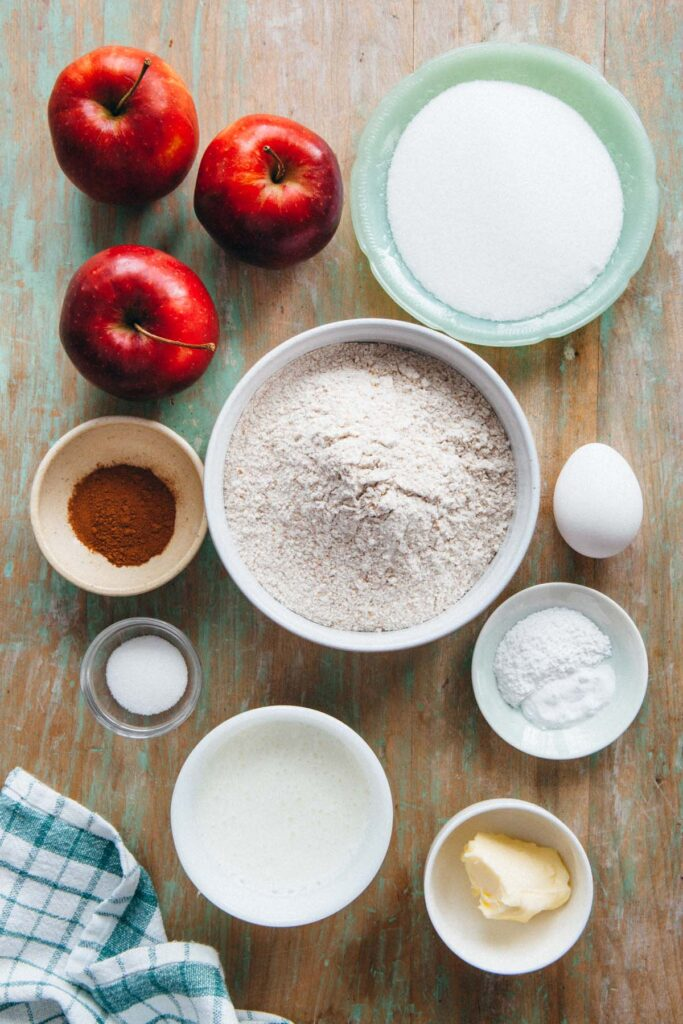 Ingredients portioned out and laid out on a table to make apple cinnamon loaf.