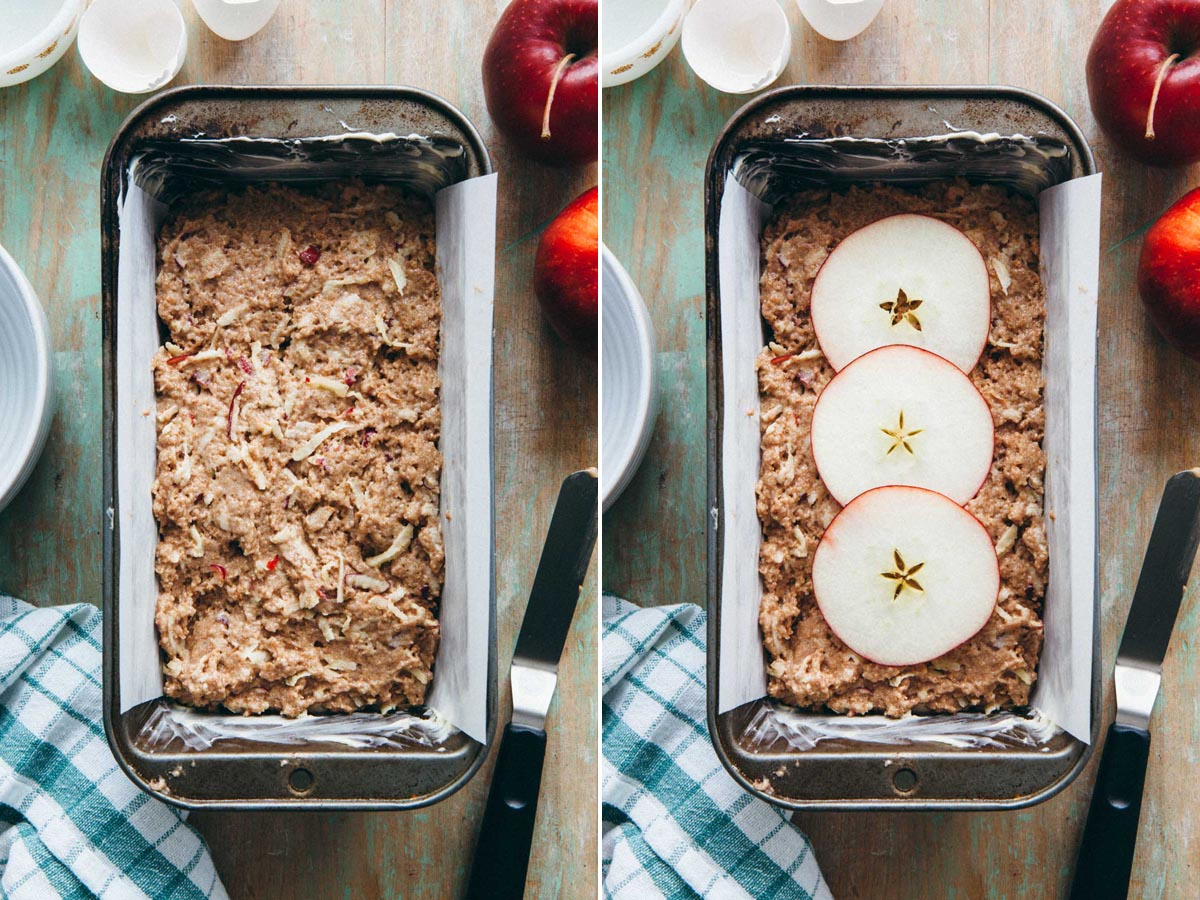 Unbaked batter in a loaf tin topped with thin round apple slices.