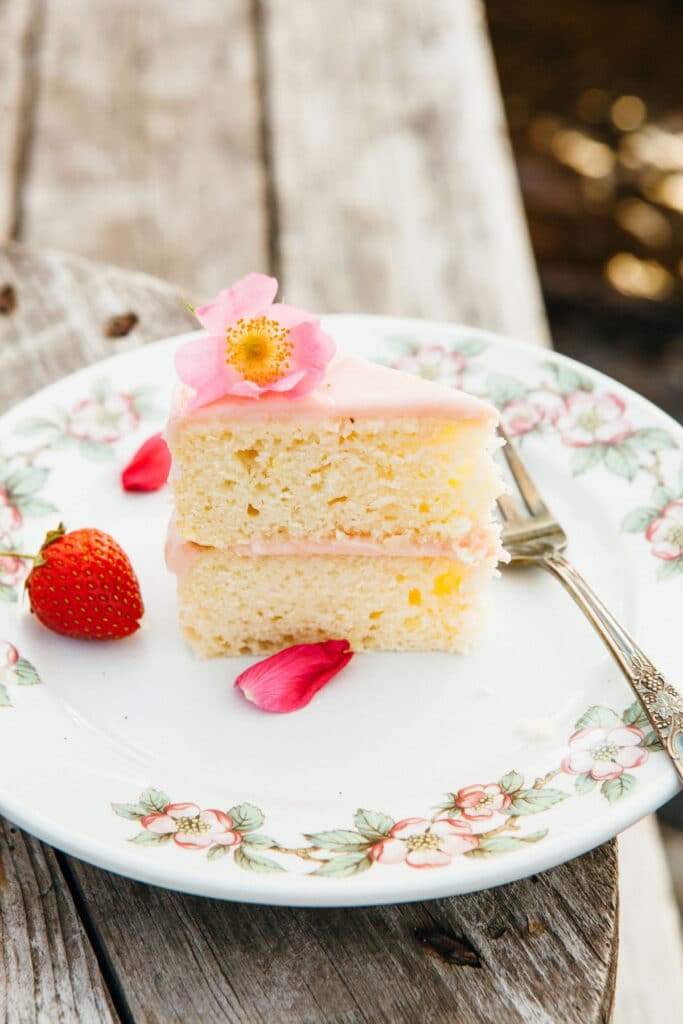 A slice of lemon buttermilk cake with strawberry jam-cream cheese icing.