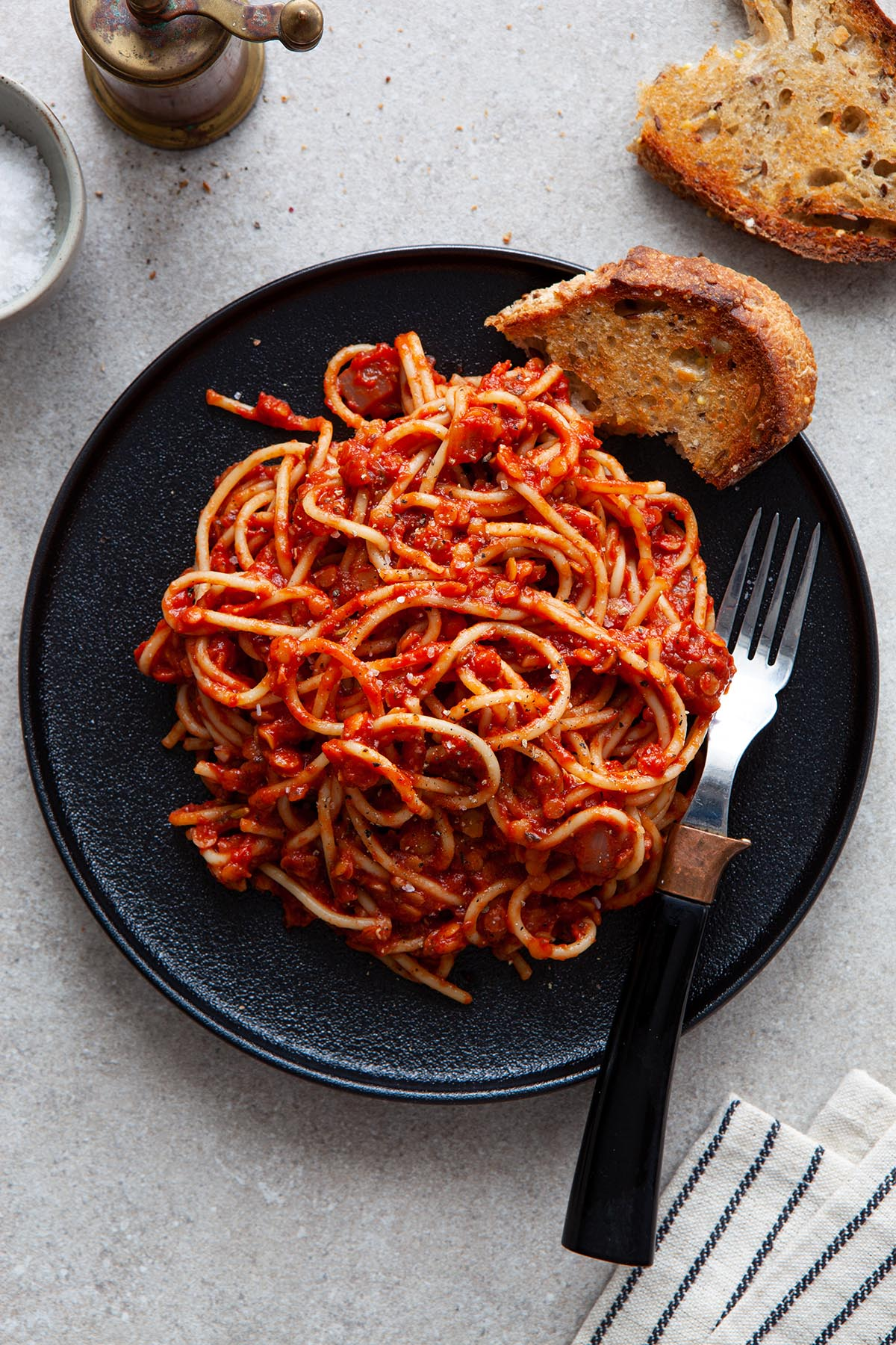 A plate of spaghetti tossed with vegan lentil Bolognese sauce.