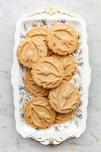 A decoartive platter of brown sugar shortbread cookies.